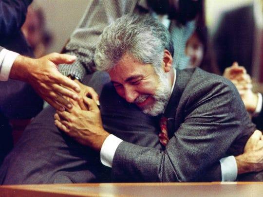 On Oct. 5, 1990, Contemporary Arts Center director Dennis Barrie hugs his attorney H. Louis Sirkin after he was acquitted of obscenity charges stemming from a Robert Mapplethorpe exhibit at the CAC.