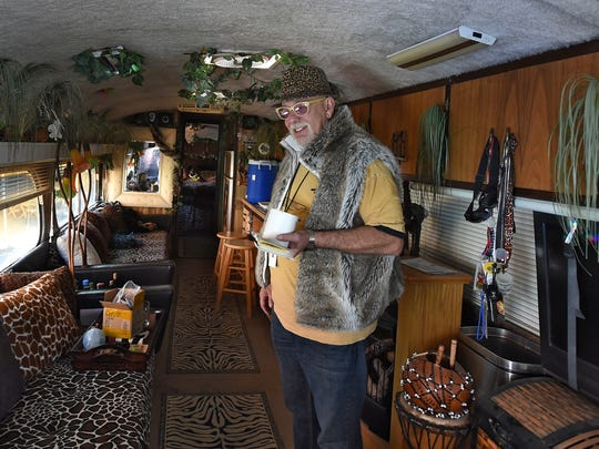 """""""Jungle"""" Jim Gibson, owner of the Morris Burner Hotel, stands inside his bus he named The Jungle Bus. ."""
