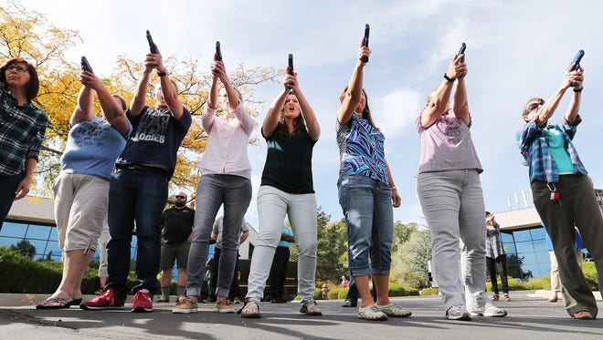 Teachers practice during a concealed firearm permit class in South Jordan, Utah. Utah allows permitted concealed weapons in public schools.