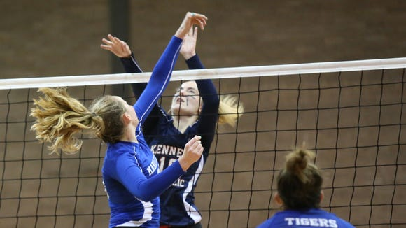 Kennedy Catholic's Kelly Brann (10) and Maria Regina's Kaitlyn Downey (23) battle at the net during the CHSAA volleyball championship match at Kennedy Catholic High School in Somers on Thursday, November 2, 2017.