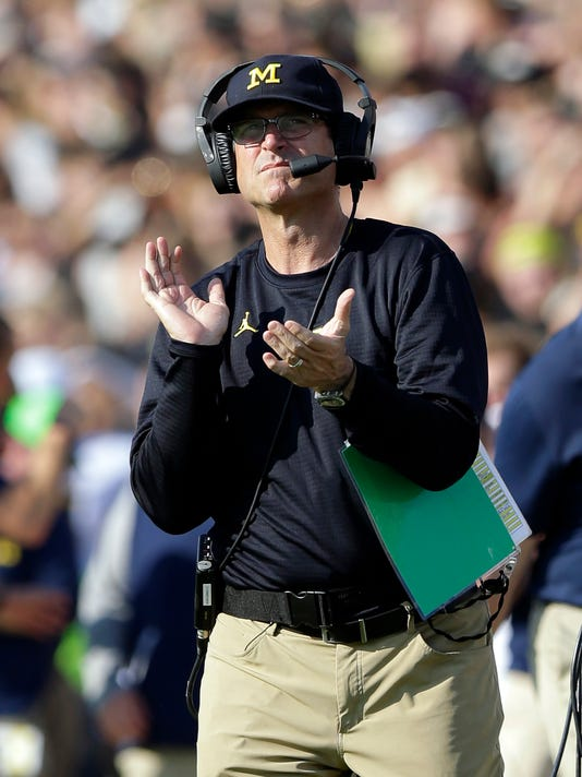 Michigan head coach Jim Harbaugh claps after a touchdown against the Purdue during the first half of an NCAA college football game in West Lafayette, Ind., Saturday, Sept. 23, 2017. (AP Photo/Michael Conroy)