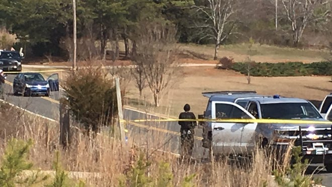 Officers from the Oconee County Sheriff's Office and the South Carolina Law Enforcement Division investigate at the scene of an officer-involved shooting Saturday morning near Oakway.