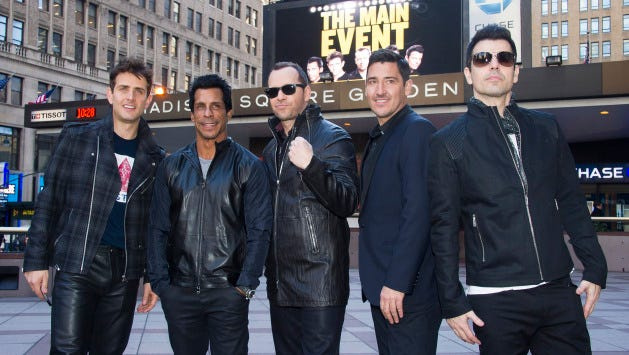 """New Kids Kids On The Block members, from left, Joey McIntyre, Danny Wood, Donnie Wahlberg, Jonathan Knight and Jordan Knight announce their """"The Main Event"""" tour at Madison Square Garden on Tuesday, Jan. 20, 2015, in New York."""