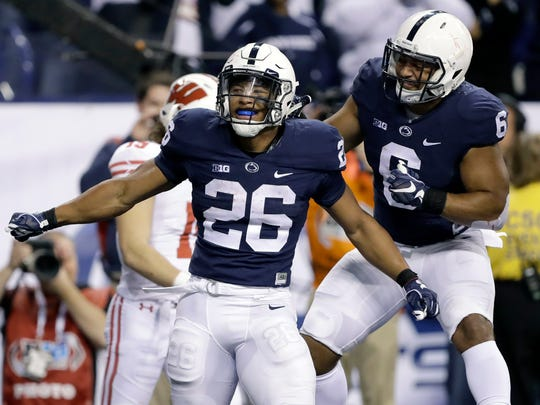 Penn State's Saquon Barkley (26) during the Big Ten Championship game on Dec. 3, 2016, in Indianapolis. (AP Photo/Michael Conroy)
