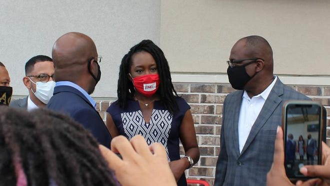 Shalena Cook Jones, center, attends a campaign event for Raphael Warnock in September. Jones, who was running for Chatham County District Attorney, defeated incumbent Meg Heap this week by about 7,300 votes.