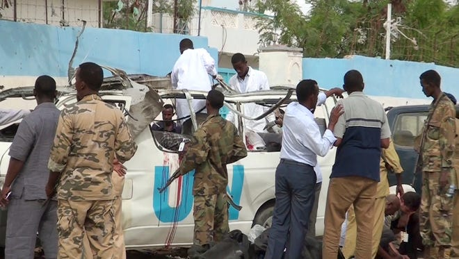 This image made from video shows the scene following a bomb attack on a van carrying U.N. employees in Garowe, in the semiautonomous Puntland region of northern Somalia.