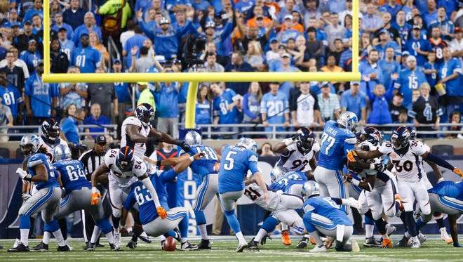 The Denver Broncos block an extra point attempt by Detroit Lions kicker Matt Prater at Ford Field in Detroit on Sunday, Sept. 27, 2015.
