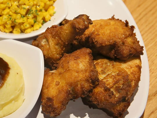 Fried chicken has thin, crisp breading; it comes with