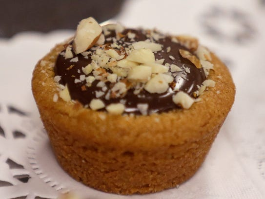 Fudge Puddles (gooey chocolate in a peanut butter cup-shaped cookie ...
