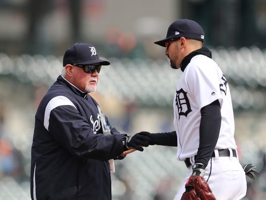 Detroit Tigers manager Ron Gardenhire greets right fielder Nicholas Castellanos after a baseball game against the Kansas City Royals, Monday, April 2, 2018, in Detroit. Detroit won 6-1. (AP Photo/Carlos Osorio)