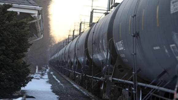 A CSX locomotive pulling tanker cars used for crude