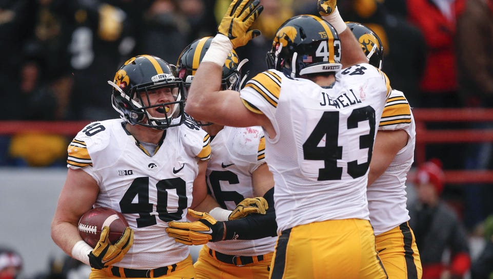 Waukon native Parker Hesse (40) is joined in celebration