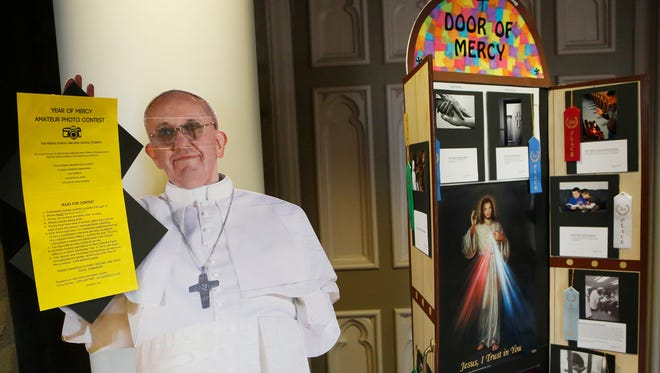 A cardboard cutout of Pope Francis is posted outside the sanctuary during the morning mass Wednesday, March 16, 2016, at St. Mary Cathedral, 1212 South Street, Lafayette.