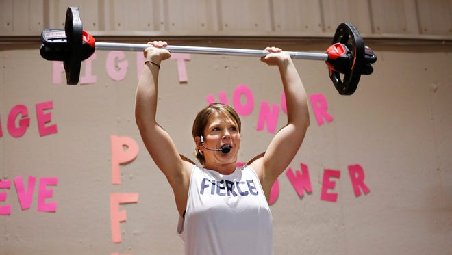 Tara Seaburg leads participants in Pump for Pink Saturday, October 1, 2016, at Club Newtone, 725 Sagamore Parkway North in Lafayette.