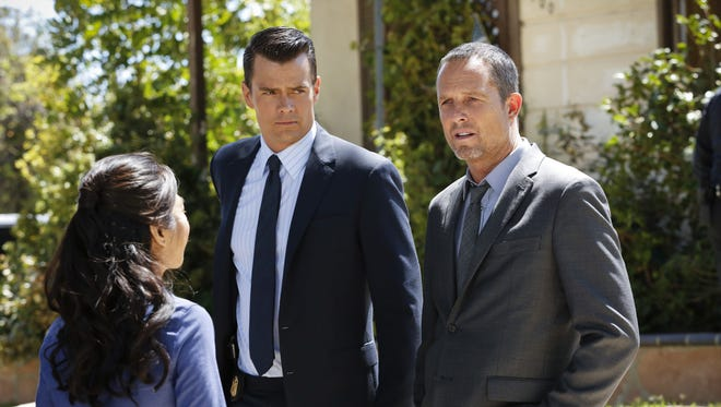 """Josh Duhamel and Dean Winters appear in a scene from """"Battle Creek,"""" airing Sunday at 10 p.m. EDT."""