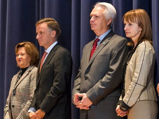 Members of all three branches of state government appear on stage during a charity event in Nashville on Friday, Jan. 16, 2015. From left are Supreme Court Chief Justice Sharon Lee, Gov. Bill Haslam, Senate Speaker Ron Ramsey and House Speaker Beth Harwell.