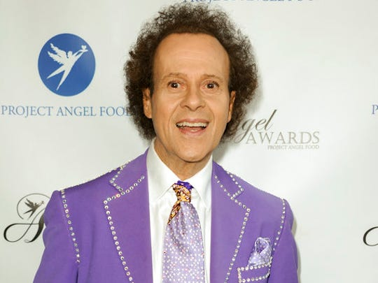 FILE - In this Aug. 10, 2013 file photo, fitness guru Richard Simmons arrives at the Project Angel Food's 2013 Angel Awards in Los Angeles. Despite what seems to be a national obsession with the fitness guru's wellbeing, his publicist, manager, brother and two officers from the LAPD have all said the 68-year-old is at home in the Hollywood Hills and doing fine.