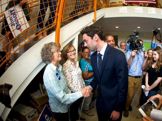Democratic candidate for Georgia's Sixth Congressional seat Jon Ossoff greets supporters at a campaign field office Tuesday, April 18, 2017, in Marietta. Voters began casting ballots on Tuesday in the special election to fill the House seat vacated by Health and Human Services Secretary Tom Price.