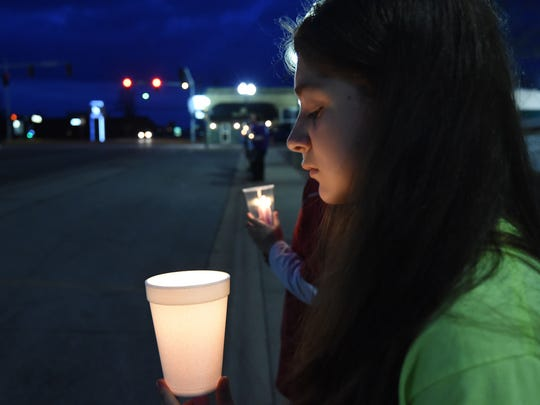 Jordan Francis, 14, a friend of Raul Turrieta, holds a candle Thursday evening during a candlelight vigil held on the two-year anniversary of his murder.