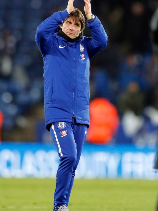 Chelsea's team manager Antonio Conte greets supporters at the end of the English FA Cup quarterfinal soccer match between Leicester City and Chelsea, at the King Power stadium in Leicester, England, Sunday, March 18, 2018. (AP Photo/Frank Augstein)