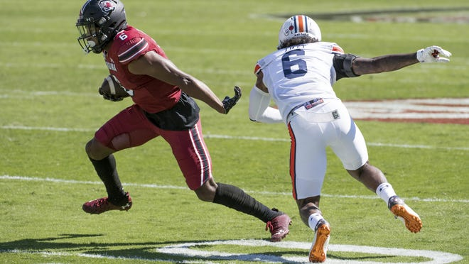 South Carolina wide receiver Josh Vann (6) runs with the ball against Auburn defensive back Christian Tutt (6) during the first half Saturday in Columbia, S.C.