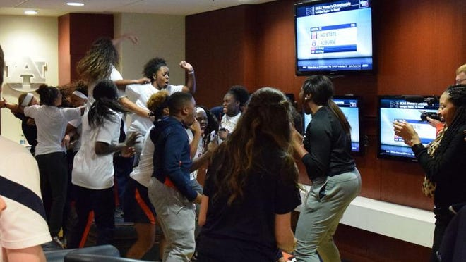 The Auburn women's basketball team celebrates being selected to the NCAA Tournament on Monday at Auburn Arena.