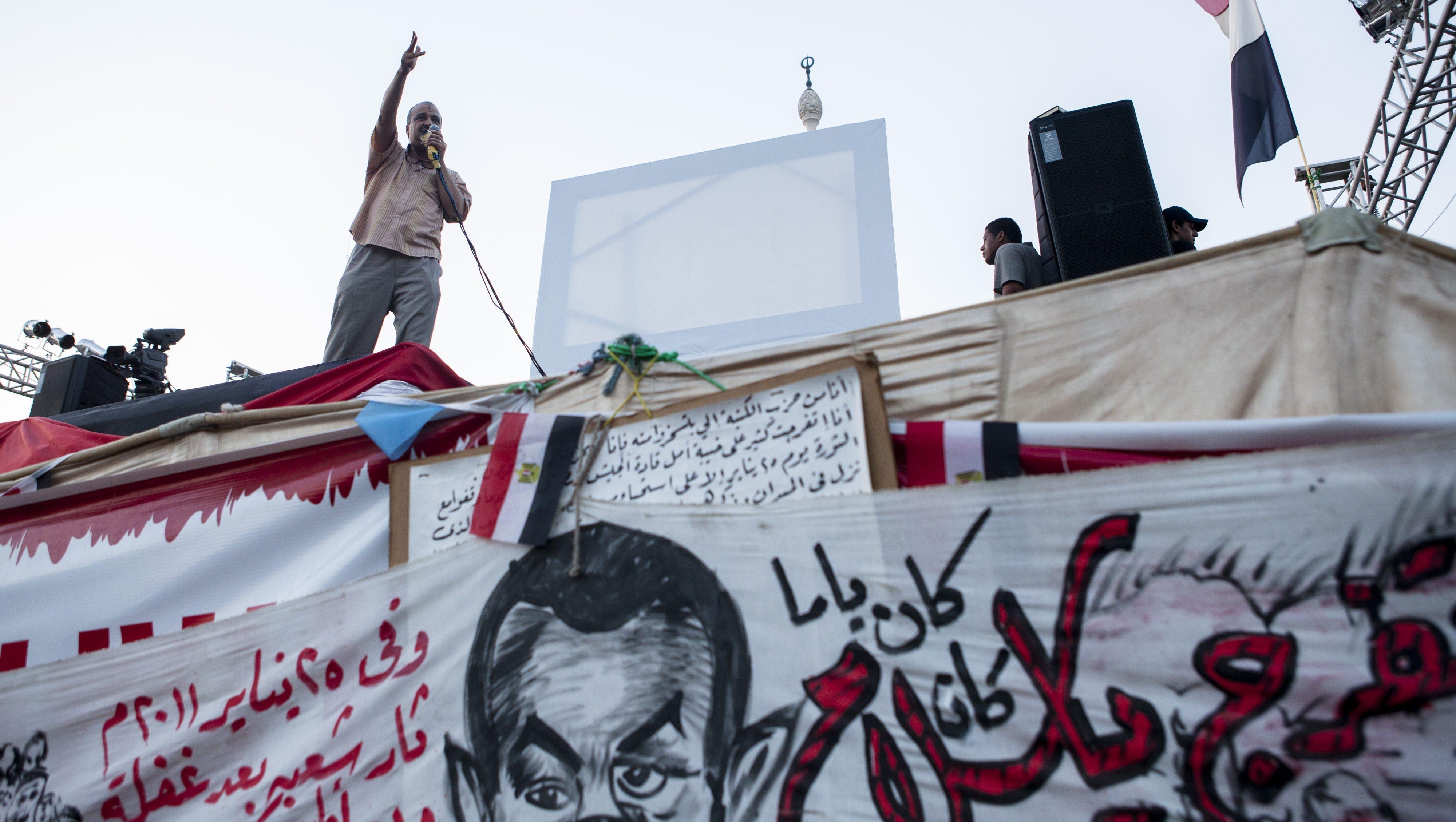 Senior Muslim Brotherhood member Mohammed al-Beltagy addresses Morsi supporters at a sit-in on Aug. 12.