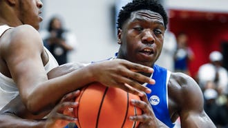 Bluff City Legends forward Malcolm Dandridge (right) grabs a rebound against PSA Cardinals defender Joel Soriano (left) during their Nike EYBL game in Dallas, Texas.
