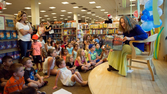 "Barnes & Noble story-teller Kyle Tarvin reads ""Finding Dory Big Golden Book"" to children during the Mesilla Valley Mall retailers ""Get Pop-Cultured: Finding Dory"" event Friday July 8, 2016. About 60 children showed up to the event."
