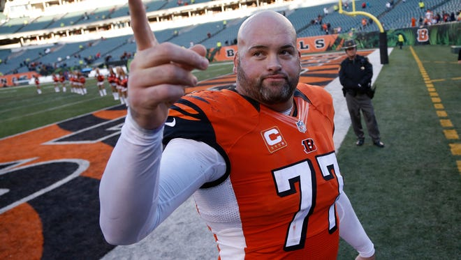 The Cincinnati Bengals tackle Andrew Whitworth (77) celebrates their 33-23 win over the Jacksonville Jaguars at Paul Brown Stadium.  The Enquirer/Jeff Swinger