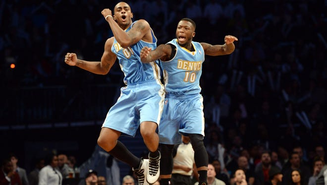 Denver Nuggets power forward Darrell Arthur and point guard Nate Robinson celebrate against the Brooklyn Nets during the second half at Barclays Center.