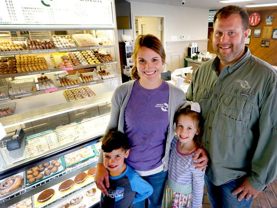Donut Country owners Kristy and Bo Davis stand with their children Bennett, 5, and Hadley, 8. The shop is vying for top spot in the Sweetest Bakery in America contest, which is going on through July 31. The family is photographed ona Thursday, April 5, 2018.