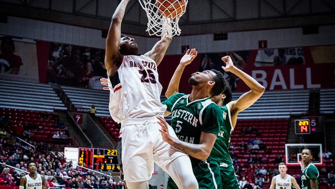 Ball State's Tahjai Teague dunks against Eastern Michigan's defense during their game at Worthen Arena Tuesday, Jan. 2, 2018.