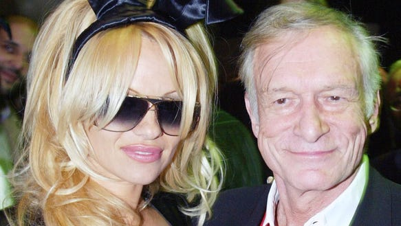 Pamela Anderson with Pamela Anderson and Hugh Hefner