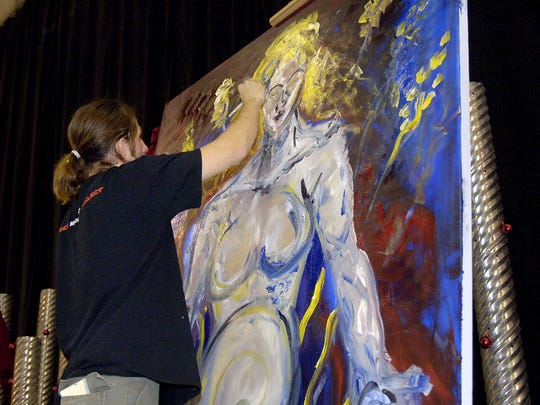 Artist J. Brommel painted a big canvas for a Metro Arts Alliance auction in 2006.