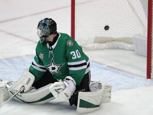 Dallas Stars goaltender Ben Bishop (30) allows the goal by Columbus Blue Jackets right wing Oliver Bjorkstrand, not shown, during the third period of an NHL hockey game in Dallas, Tuesday, Jan. 2, 2018. The Blue Jackets won 2-1. (AP Photo/LM Otero)