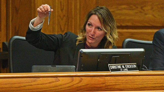 Sioux Falls City Council Member Christine Erickson offers Mayor Mike Huether a pen once used by Gov. Dennis Daugaard before the Mayor signed the outdoor smoking ban ordinance during a Sioux Falls City Council meeting Tuesday, May 2, 2017, at Carnegie Town Hall in Sioux Falls.  The City Council passed an outdoor public smoking during Tuesday's meeting.
