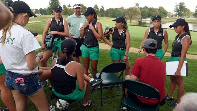North players gather around the 18th green after completing their rounds during the Girls Golf Regional at Country Oaks Golf Club in Montgomery Saturday.  North won the Regional with a 296.