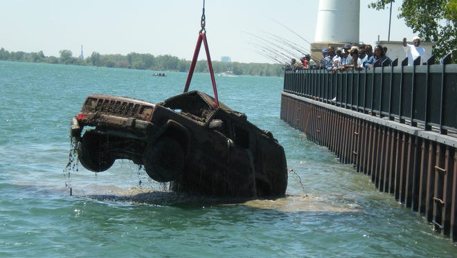 A Jeep Cherokee, discovered by someone who was fishing, is removed from the Detroit River in this photo dated May 20, 2009.