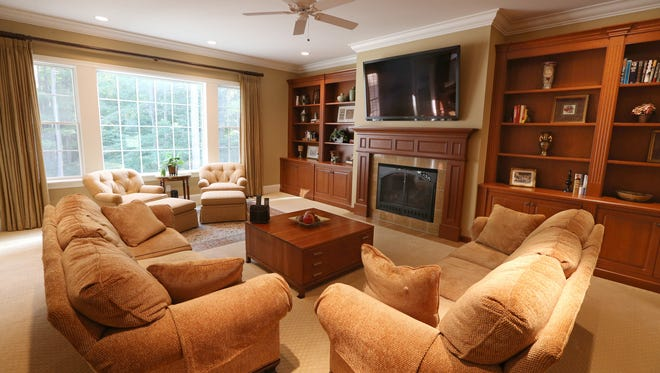 The living room at 27 Greythorne Hill in Pittsford Monday, Sept. 25, 2017.