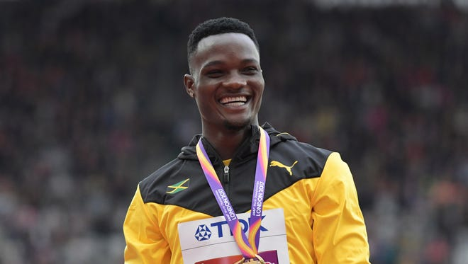 Omar McLeod of Jamaica with his gold medal after winning the 110 hurdles at the 2017 world championships in London. He is the reigning Olympic and world champion.