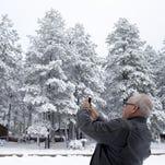 Matthew Darmody photographs the snow, November 4, 2015, in Munds Park, Arizona.