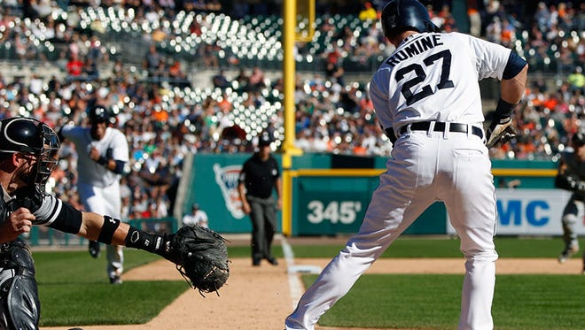 Tigers shortstop Andrew Romine lays down a squeeze bunt during Wednesday's win over the White Sox at Comerica Park.