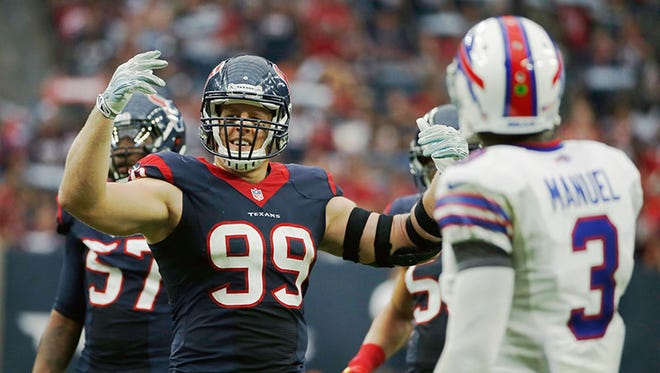 Texans defensive end J.J. Watt cheers as Bills QB E.J. Manuel looks on during Sunday's game in Houston.