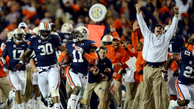 Auburn cornerback Chris Davis (11) runs for the winning 100-yard touchdown run in the Iron Bowl at Jordan-Hare Stadium on Saturday, Nov. 30, 2013.