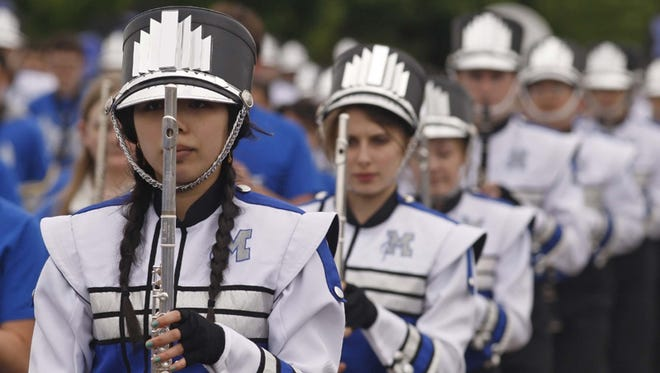 Members of the McNary High Marching Celtics during the Keizer Iris Festival Parade in 2013.