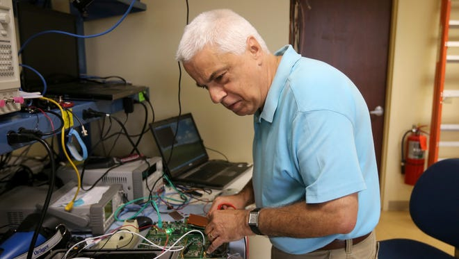 Wilhelm Riedl, a principal Radio Frequency  engineer, working on developing and validating circuit board designs at Vanteon Corp. in Perinton.