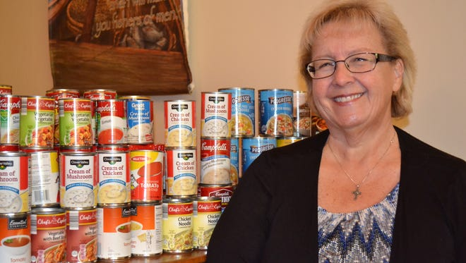 ": Pastor Candy Seaman of Clyde Christian Church with some of the cans of soup her church has collected for the Clyde Food Pantry. Seaman heads up the Clyde-Green Springs-Vickery Ministerial Association, whose churches are combining efforts to collect soup for the food panty and host a Feb. 3 ""Souper Bowl Community Supper"" that will raise money for the group's outreach fund."