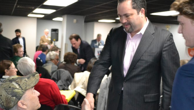 Ben Jealous, a Democratic candidate for governor, talks to an audience member before the start of a candidates forum in Salisbury on Friday, March 9.