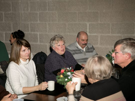 Pictured at the Holyland Food Pantry annual meeting are, from left: Barb Mills, Mary and Dwight Sattler; and facing away are, from left: Mary Stellick and Blair Mills.